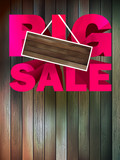 Big sale with wood for copy space.