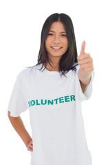 Cheerful volunteer woman with thumb up