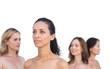 Pensive nude models posing looking away