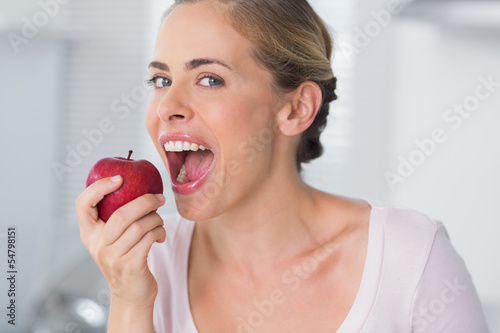 Woman munching apple