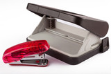 Red stapler and puncher isolated on the white background