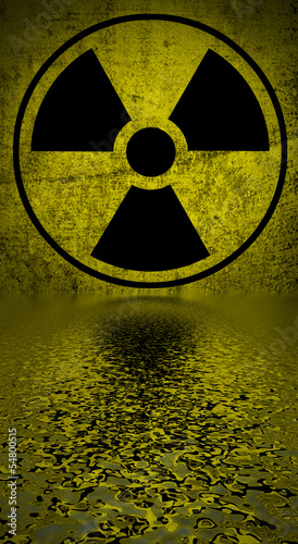 Ionizing radiation hazard symbol reflected in water surface.