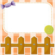 An empty paper note with candies and a wooden fence
