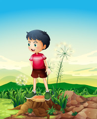 A little boy standing above the stump