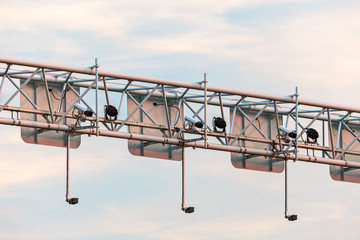 Surveillance camera system above a highway
