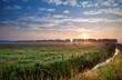 sunrise over green pastoral