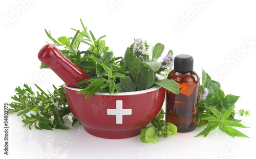Aluminium Spices Mortar with medicine cross, fresh herbs and essential oil bottle