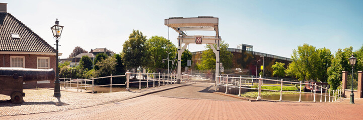 Panoramic photo of dutch city Leiden in summer. Bridge at Morspo