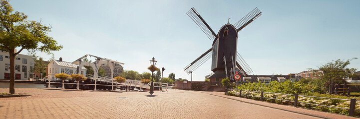 Panoramic photo of dutch city Leiden in summer. Windmill and old