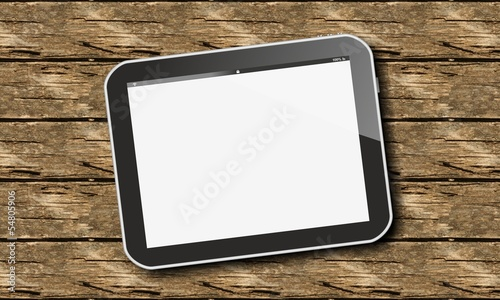 tablet pc on wood
