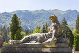 Stone statue in the garden of Peles castle in Sinaia, Romania. poster