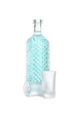 Bottle of vodka with wineglass isolated on white