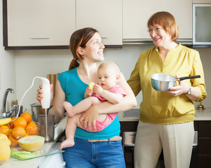 Happy family cooking fruit puree