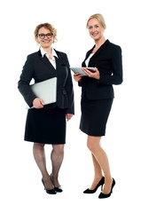 Attractive female executives, full length shot