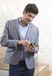 Happy man using cellphone