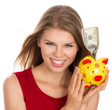 Happy smiling Caucasian girl holding dollars piggy bank