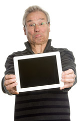 Senior Caucasian man portrait series, showing tablet computer