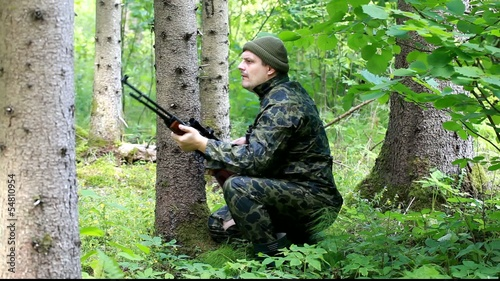 Man with optical rifle  and  binoculars in the woods episode 5