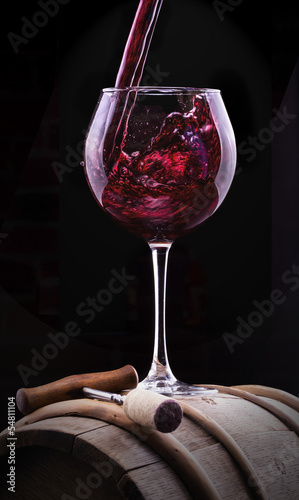 Splash red wine against a black background