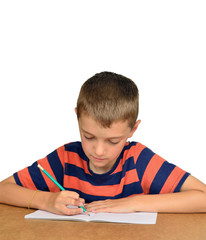 Boy writing in the notebook