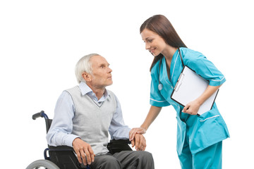 Senior care. Confident young nurse holding senior man hand and s
