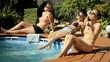 Girls taking sunbath by the pool