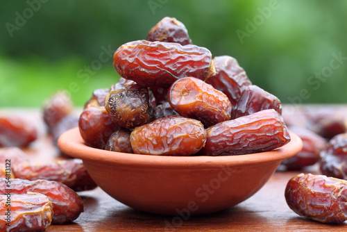 Fresh Arabian Dates with a brown bowl
