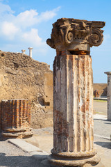 antique stone statue. at the ancient Roman city of Pompeii
