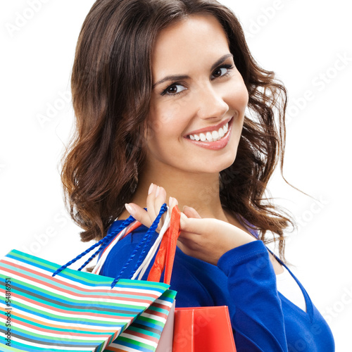 Young woman with shopping bags, isolated