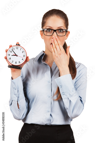 Young woman with an alarm clock in a hand