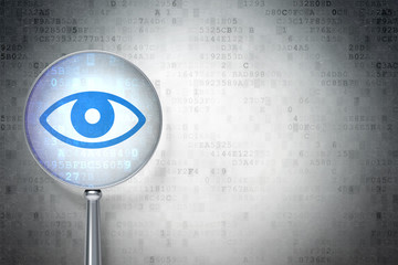 Education protection concept:  Eye with optical glass on digital