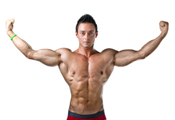 Handsome young bodybuilder  with arms spread open