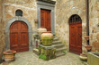 three antique doors in italian village Civita di Bagnoregio