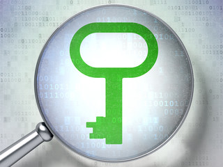 Security concept:  Key with optical glass on digital background