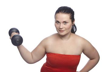 Frau bei Übungen mit der Hantel