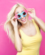 Beautiful young cheerful woman wearing funny sunglasses