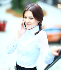 Pretty young business woman using mobile phone
