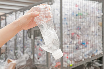 used plastic bottle in hand