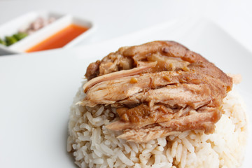Pork leg with rice close up isolated on white background