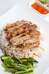 Pork leg with rice on white background