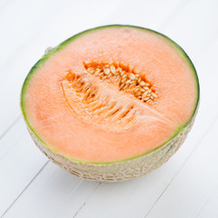 Ripe cantaloupe melon, close-up, studio shot