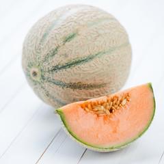 Still life fruits: cantaloupe melon, studio shot