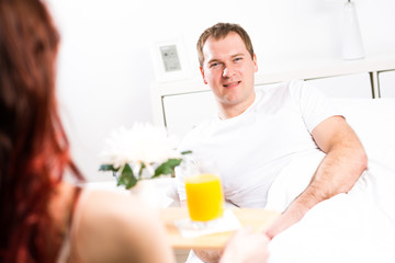 woman brought her boyfriend breakfast in bed