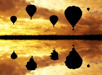 Air Balloon over Lake at Sunset