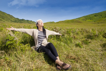 Attractive woman enjoying fresh air
