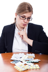 Woman choosing pills