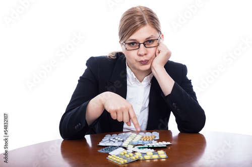 Serious woman pointing at pills