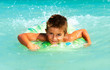 Happy Child Playing in Swimming in Sea. Summer Vacations Concept