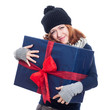 Satisfied winter woman with big present