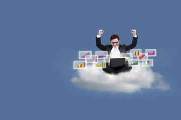 Happy businessman with bar chart on cloud